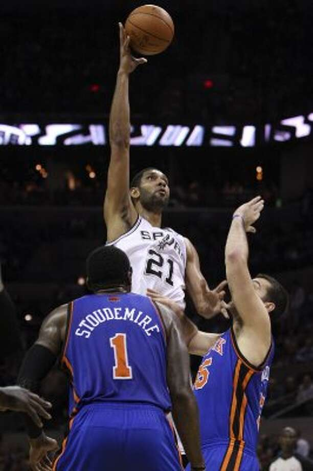 SPURS -- San Antonio Spurs Tim Duncan shoots over New York Knicks Amar'e Stoudemire and Josh Harrellson during the second half at the AT&T Center, Wednesday, March 7, 2012. The Spurs won 118-105. Jerry Lara/San Antonio Express-News (Jerry Lara / San Antonio Express-News)