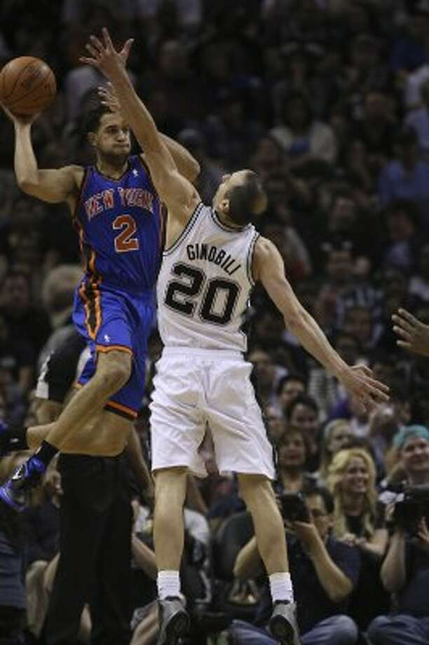 The Spurs' Manu Ginobili puts pressure on the Knicks' Landry Fields during the second half at the AT&T Center, Wednesday, March 7, 2012. The Spurs won 118-105. Jerry Lara/San Antonio Express-News (Jerry Lara / San Antonio Express-News)