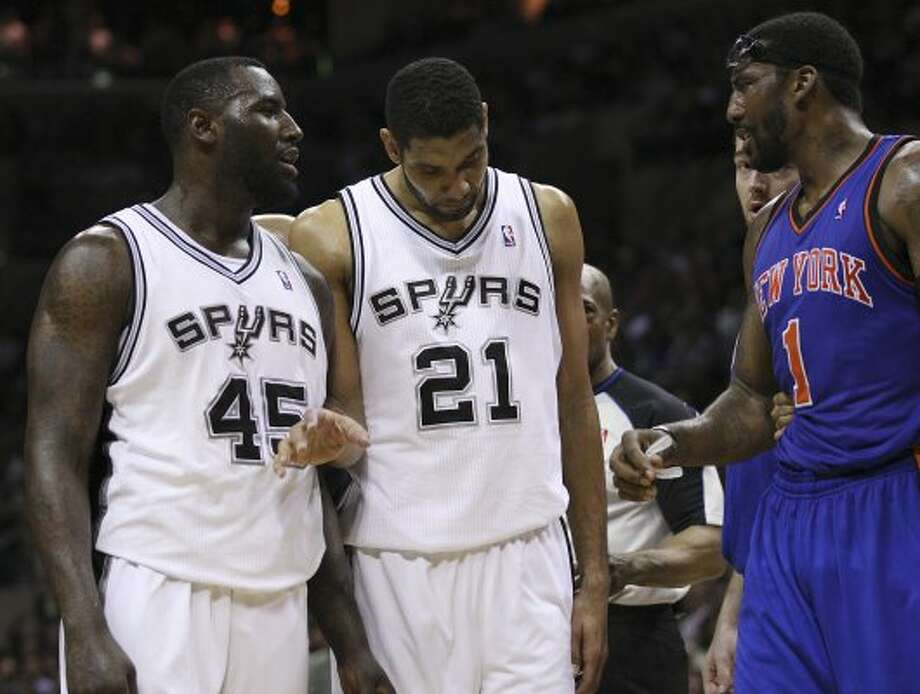 Spurs forward Tim Duncan (center) keeps DeJuan Blai (left) and the Knicks' Amar'e Stoudemire away from each other during the second half at the AT&T Center, Wednesday, March 7, 2012. The Spurs won 118-105. Jerry Lara/San Antonio Express-News (Jerry Lara / San Antonio Express-News)
