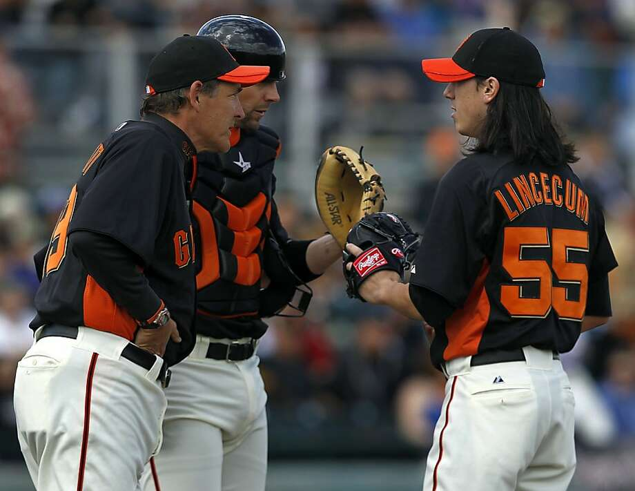 Pitching coach Dave Righetti and catcher Chris Stewart meet with Tim Lincecum in the 2nd inning of the San Francisco Giants Cactus League spring training game against the Colorado Rockies in Scottsdale, Ariz. on Wednesday, March 7, 2012. Photo: Paul Chinn, The Chronicle