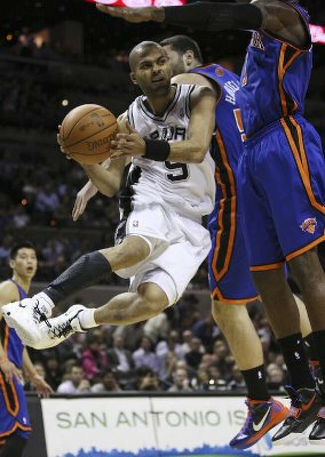 SPURS -- San Antonio Spurs Tony Parker looks to pass out to the perimeter under pressure from New York Knicks Josh Harrellson and Amar'e Stoudemire during the first half at the AT&T Center, Wednesday, March 7, 2012. Jerry Lara/San Antonio Express-News (Jerry Lara / San Antonio Express-News)