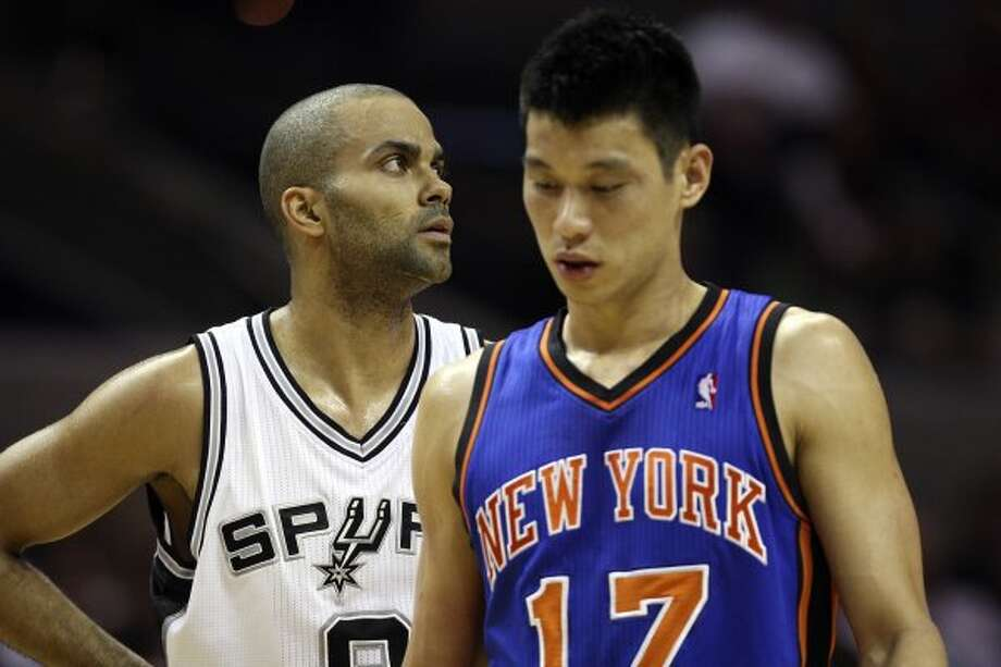 The Spurs' Tony Parker and Knicks'  Jeremy Lin get back on the court after a time out during the first half at the AT&T Center, Wednesday, March 7, 2012. Jerry Lara/San Antonio Express-News (Jerry Lara / San Antonio Express-News)