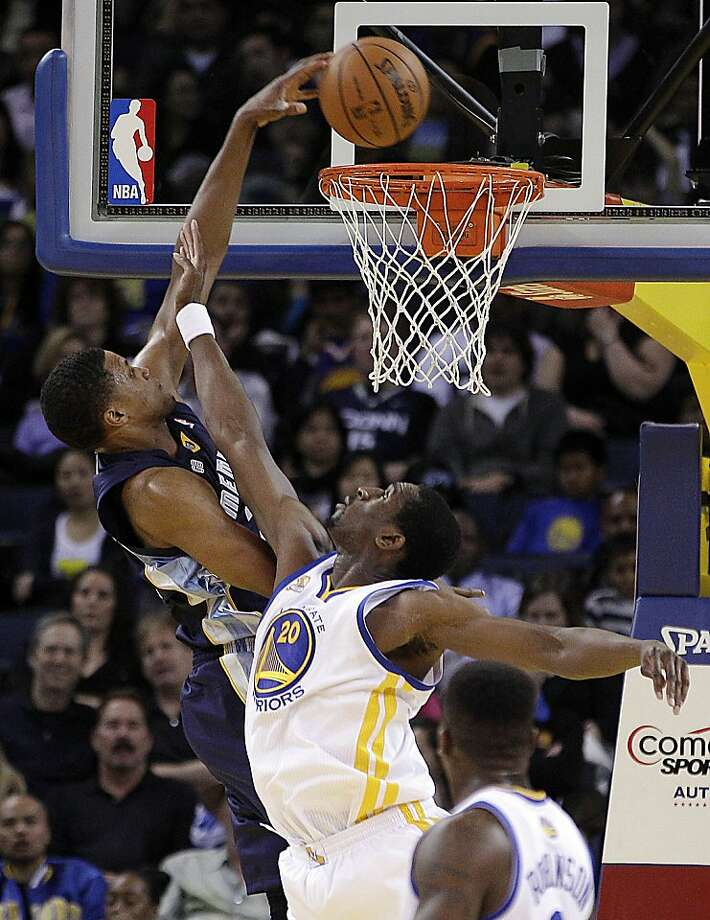 Memphis Grizzlies' Rudy Gay scores over Golden State Warriors' Ekpe Udoh during the first half of an NBA basketball game Wednesday, March 7, 2012, in Oakland, Calif. (AP Photo/Ben Margot) Photo: Ben Margot, Associated Press