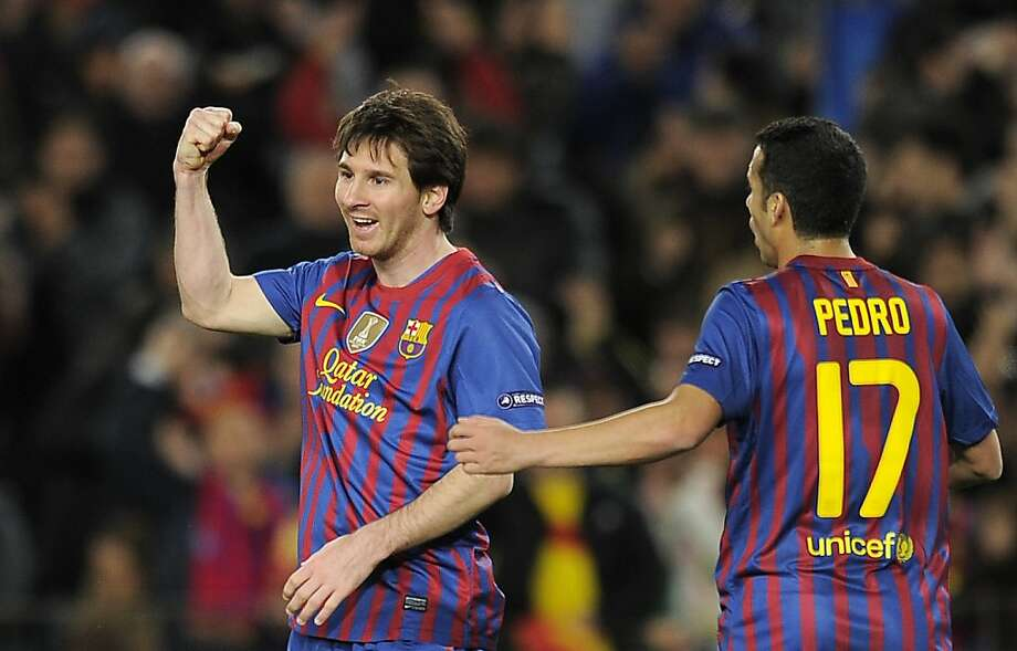 Barcelona's Argentinian forward Lionel Messi (L) celebrates after scoring a goal during the UEFA Champions League football match, round of 16 second leg, FC Barcelona vs Bayern 04 Leverkusen on March 7, 2012 at the Camp Nou stadium in Barcelona. AFP PHOTO/LLUIS GENE. (Photo credit should read LLUIS GENE/AFP/Getty Images) Photo: Lluis Gene, AFP/Getty Images