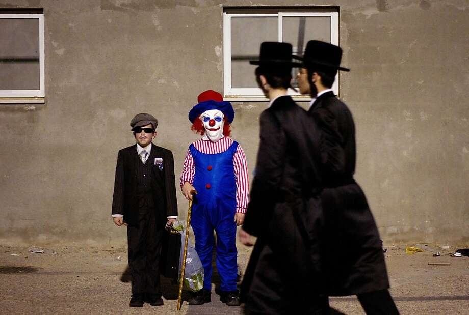 Ultra-Orthodox Jewish boys dressed for Purim pose for a photograph during celebration of Purim festival in Bnei Brak, near Tel Aviv, Israel, Wednesday, March 7, 2012. The Jewish holiday of Purim celebrates the Jews' salvation from genocide in ancient Persia, as recounted in the Scroll of Esther. (AP Photo/Ariel Schalit) Photo: Ariel Schalit, Associated Press