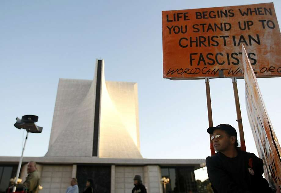 Noel Juan stands in front of St. Mary's Cathedral. Contraception Rights Activists held a rally, at the office of Archbishop Niederauer, and a march, to St. Mary's Cathedral at the office of Archbishop Niederauer, took place on Wednesday, March 7, 2012. Photo: Sean Culligan, The Chronicle