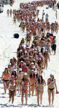 Women participate in a bikini parade in Panama City Beach, Fla. on Tuesday, March 6, 2012. Panama City Beach brought together women in an attempt to break the Guinness world record for the largest bikini parade on Tuesday. (AP Photo/The News Herald, Andrew Wardlow)  MANDATORY CREDIT Photo: Andrew Wardlow, Associated Press / The News-Herald