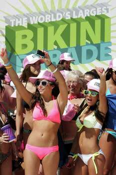 Women get ready for a bikini parade in Panama City Beach, Fla. on Tuesday, March 6, 2012. Panama City Beach brought together women in an attempt to break the Guinness world record for the largest bikini parade on Tuesday. (AP Photo/The News Herald, Andrew Wardlow)  MANDATORY CREDIT Photo: Andrew Wardlow, Associated Press / The News-Herald