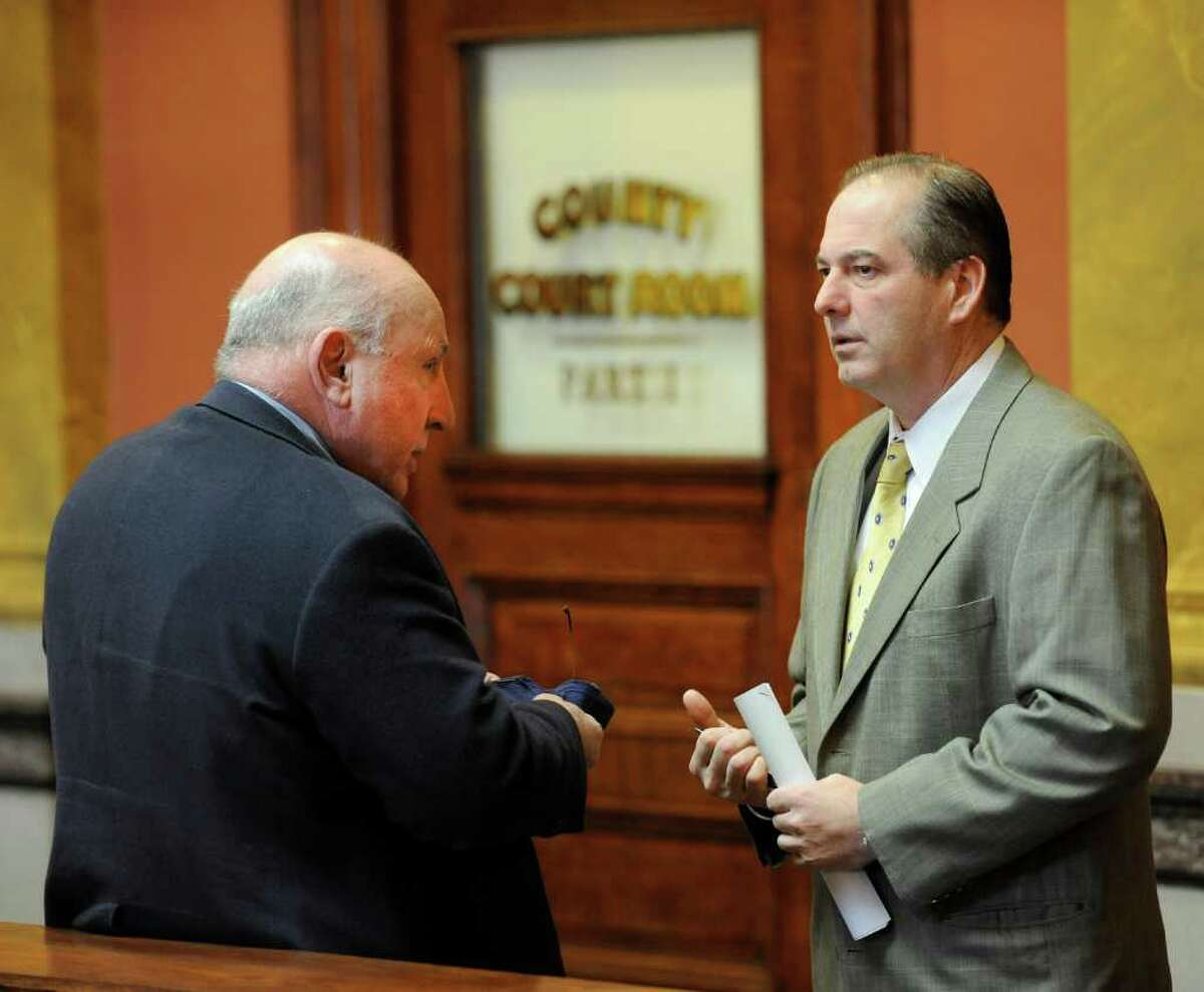 Attorneys Michael Feit, left, who represents Michael LoPorto, and Brian Premo, who represents Edward McDonough, confer outside the courtroom as deliberations continue in the ballot fraud case in the Rensselaer County Courthouse in Troy, N.Y. March 2. 2012. Deliberations were delayed Wednesday after a juror took sick and was removed from the jury room by ambulance attendants. (Skip Dickstein / Times Union)