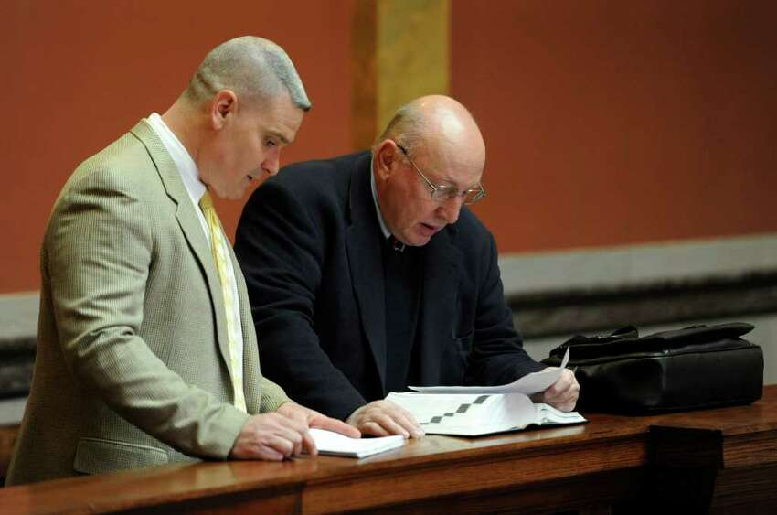 Richard F. Reilly, left, Rensselaer County Supreme and County Court Chief Clerk, speaks with attorney Michael Feit, who represents Michael LoPorto, outside the courtroom before deliberations continued in the ballot fraud case in the Rensselaer County Courthouse in Troy, N.Y. March 2. 2012. (Skip Dickstein / Times Union)