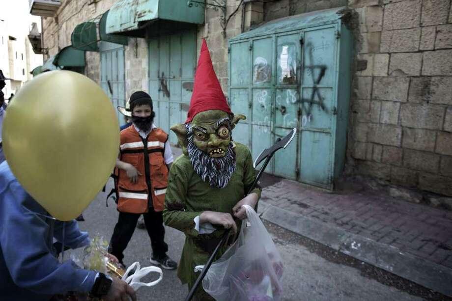 Israelis celebrate Purim with an annual parade Photo: MENAHEM KAHANA, AFP/Getty Images / AFP