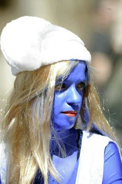 An Israeli dressed up in costume attends a parade in Holon, south of Tel Aviv, to celebrate the Puri