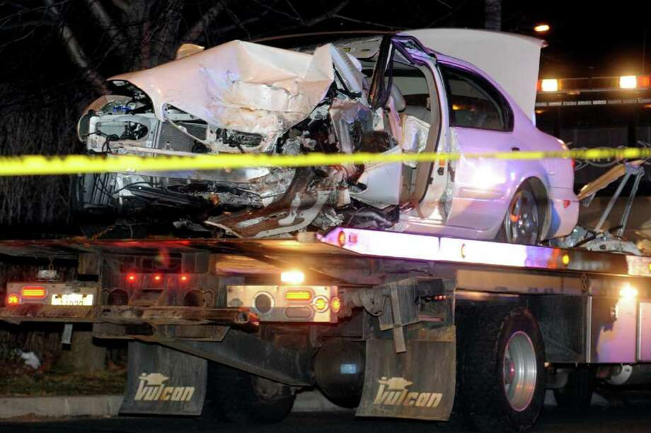 The scene of a fatal automobile accident on Burroughs Rd., in Fairfield, Conn. March 7th 2012, where a car, seen here on a flatbed, collided with a tree. Photo: Ned Gerard