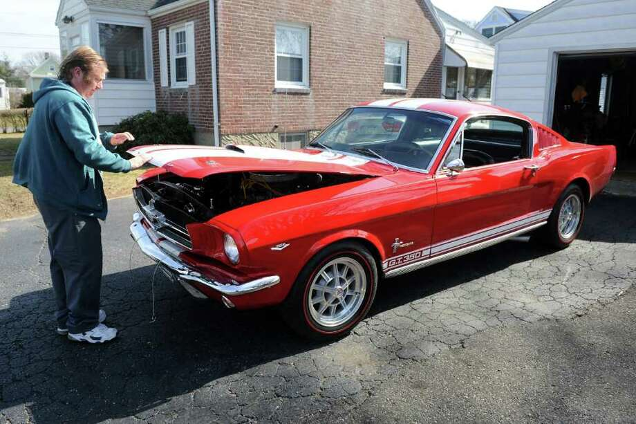 Rob Deaky, of Fairfield, closes the hood on his 1965 Ford Mustang as he get ready for an early spring drive Thursday morning, March 8th, 2012. Photo: Ned Gerard