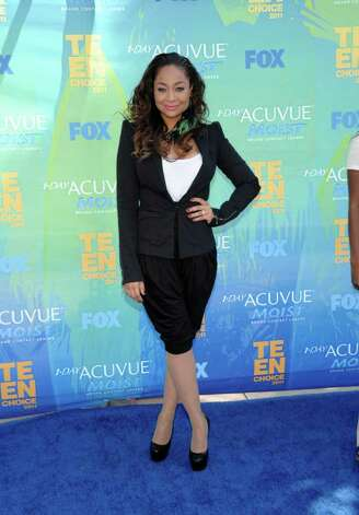 "FILE - In this Aug. 7, 2011 photo, Raven-Symone arrives at the Teen Choice Awards in Universal City, Calif.   Raven-Symone is all grown up, and going to a convent. The former ""The Cosby Show"" actress will take over the lead part in Broadway's hit musical ""Sister Act"" later this month, playing a nightclub-singer-turned-nun. Photo: AP"