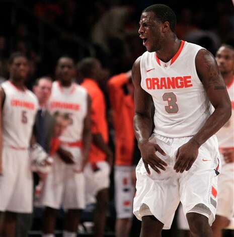 Syracuse's Dion Waiters reacts after a basket by a teammate during the  quarterfinalnam round of the Big East NCAA college basketball conference  tournament against Connecticut in New York, Thursday, March 8, 2012. Syracuse beat Connecticut 58-55. (AP Photo/Seth Wenig)