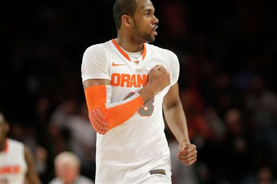 Syracuse's James Southerland reacts after scoring a three-point basket during the quarterfinal round of the Big East NCAA college basketball conference tournament against Connecticut in New York, Thursday, March 8, 2012. Syracuse beat Connecticut 58-55. (AP Photo/Seth Wenig)