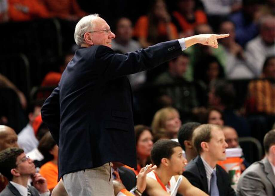 Syracuse head coach Jim Boeheim points during the quarterfinals round of the Big East NCAA college basketball conference tournament against Connecticut in New York, Thursday, March 8, 2012. Syracuse beat Connecticut 58-55. (AP Photo/Seth Wenig) / AP2012