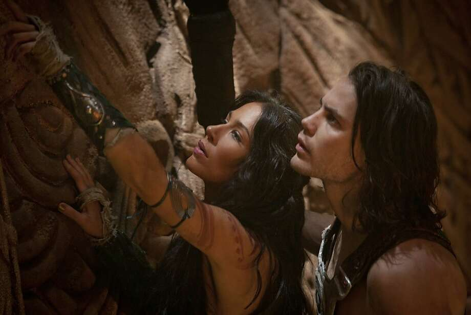 L to R: Dejah Thoris (Lynn Collins) and John Carter (Taylor Kitsch) Photo: Frank Connor, Walt Disney Pictures