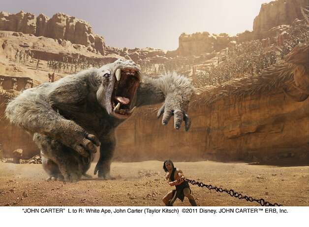 """JOHN CARTER""L to R: White Ape, John Carter (Taylor Kitsch) Photo: Walt Disney Pictures"