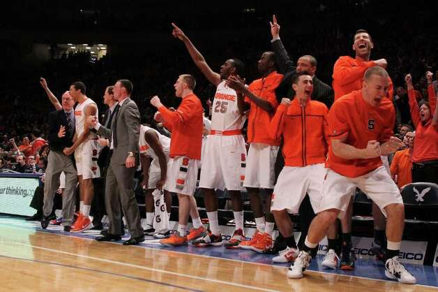 NEW YORK, NY - MARCH 08:  The Syracuse Orange bench reacts after a three pointer late in the game against the Connecticut Huskies during the quarterfinals of the Big East Men's Basketball Tournament at Madison Square Garden on March 8, 2012 in New York City.  (Photo by Jim McIsaac/Getty Images) Photo: Jim McIsaac