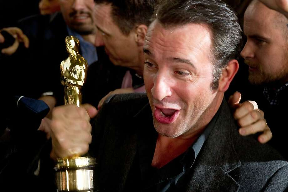 """French actor Jean Dujardin, winner of the Oscar for best actor for his role in silent movie """"The Artist, arrives at Roissy Charles de Gaulle airport on February 28, 2012 following his return from the US. Silent movie """"The Artist"""" crowned its spectacular awards season success by winning five Oscars including the Best Picture prize at the 84th Academy Awards on February 26, 2012. AFP PHOTO MARTIN BUREAU (Photo credit should read MARTIN BUREAU/AFP/Getty Images) Photo: Martin Bureau, AFP/Getty Images"""