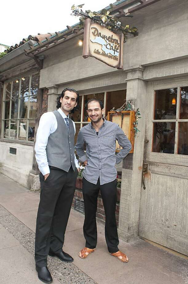 Dametra owners Bashar Sneeh and Faisal Nimri stand outside of their popular restaurant. Photo: Debra Del Toro-Phillips, Special To The Chronicle