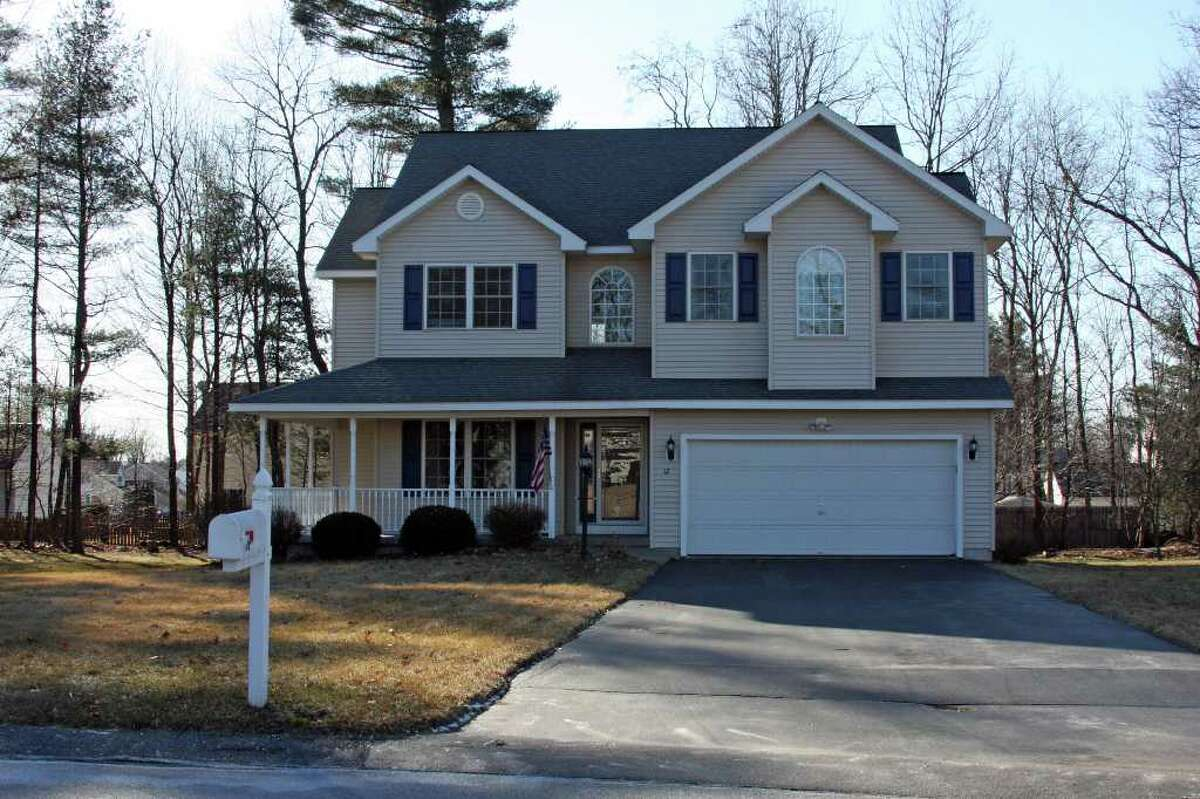 Michael Lisi photo This 2,466-square-foot custom-built Colonial with four bedrooms, 2.5 bathrooms and an attached two-car garage at 12 Berkshire Drive in Milton?s Baldwin Estates is on the market for $329,900.