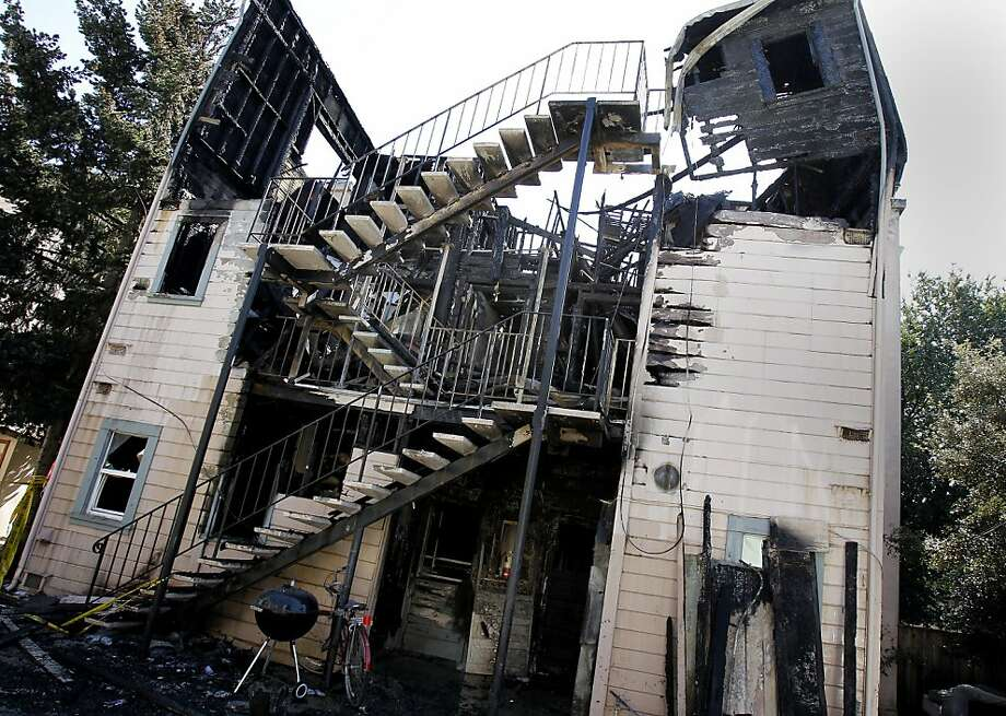 Much of the fire damage was apparent in a rear view of 2227 Dwight Way. An apartment fire on Dwight Way in Berkeley, Calif. displaced a number of UC students and also caused adjacent neighbors to leave their homes Thursday March 8, 2012. Photo: Brant Ward, The Chronicle