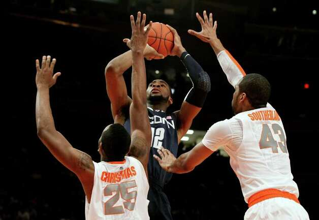 UConn's Andre Drummond shoots over Syracuse's Rakeem Christmas (25) and James Southerland (43) the quarterfinals of the Big East Tournament at Madison Square Garden Thursday. Photo: Jim McIsaac/Getty Images / 2012 Getty Images