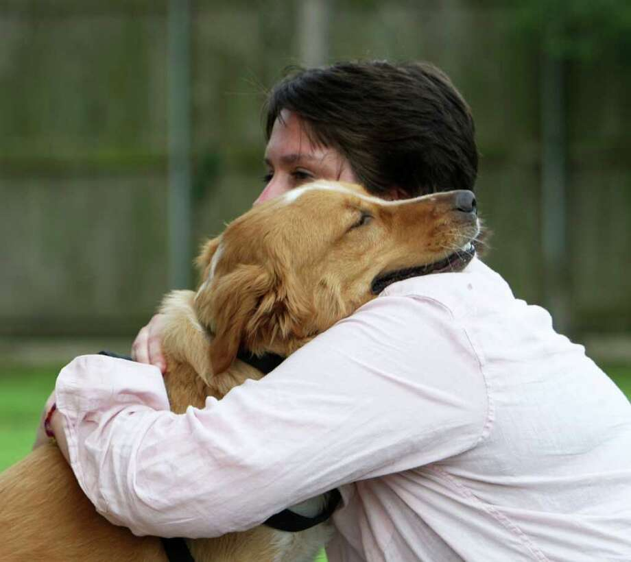Tina Borja, who has terminal cancer, needs to find a home for her dog, Buck. Photo: James Nielsen / © 2011 Houston Chronicle