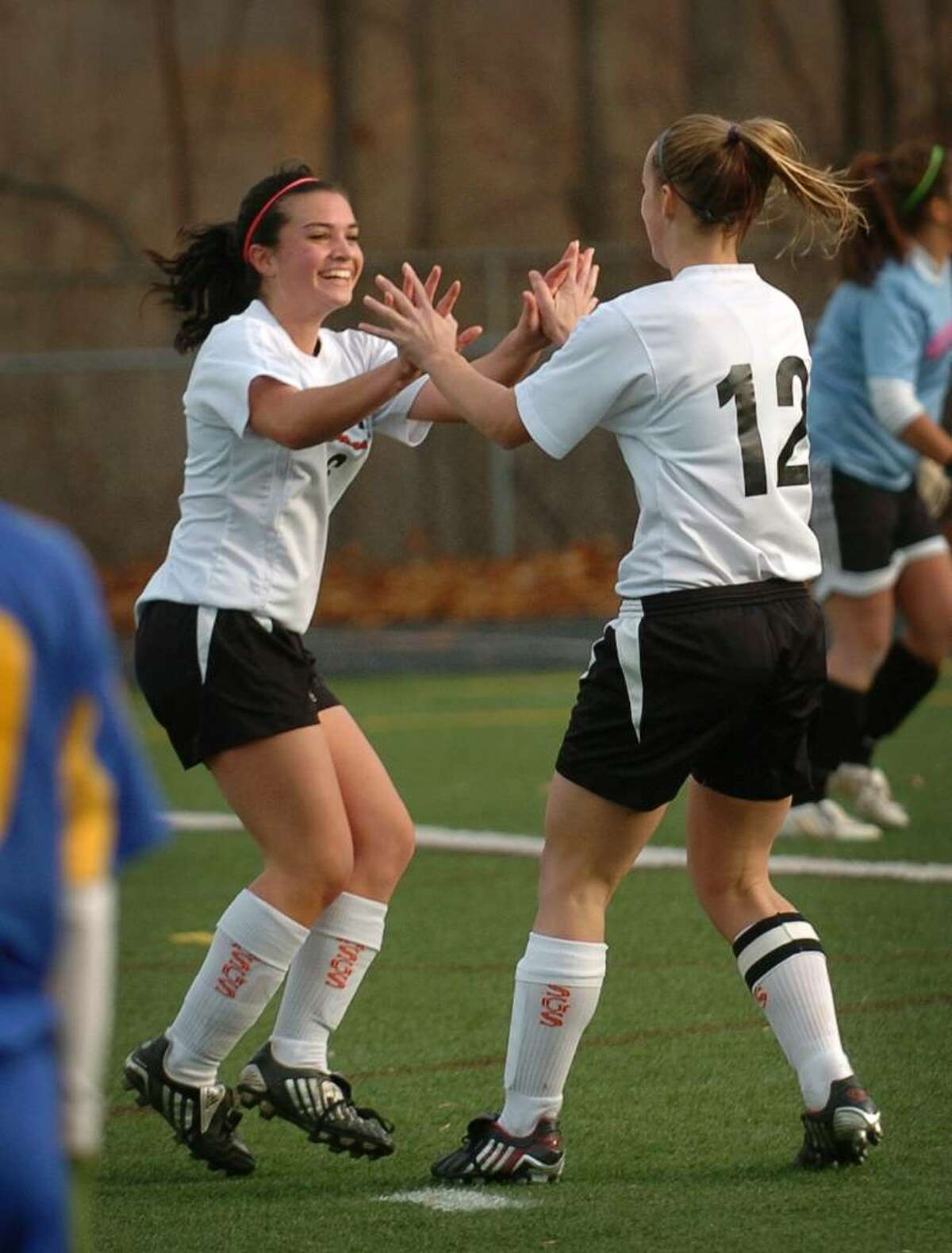 Shelton's Megan Manzo, left, and Jennifer Spicer celebrate a goal during the second half of Wednesday's Class LL state tournament game at Shelton High School.