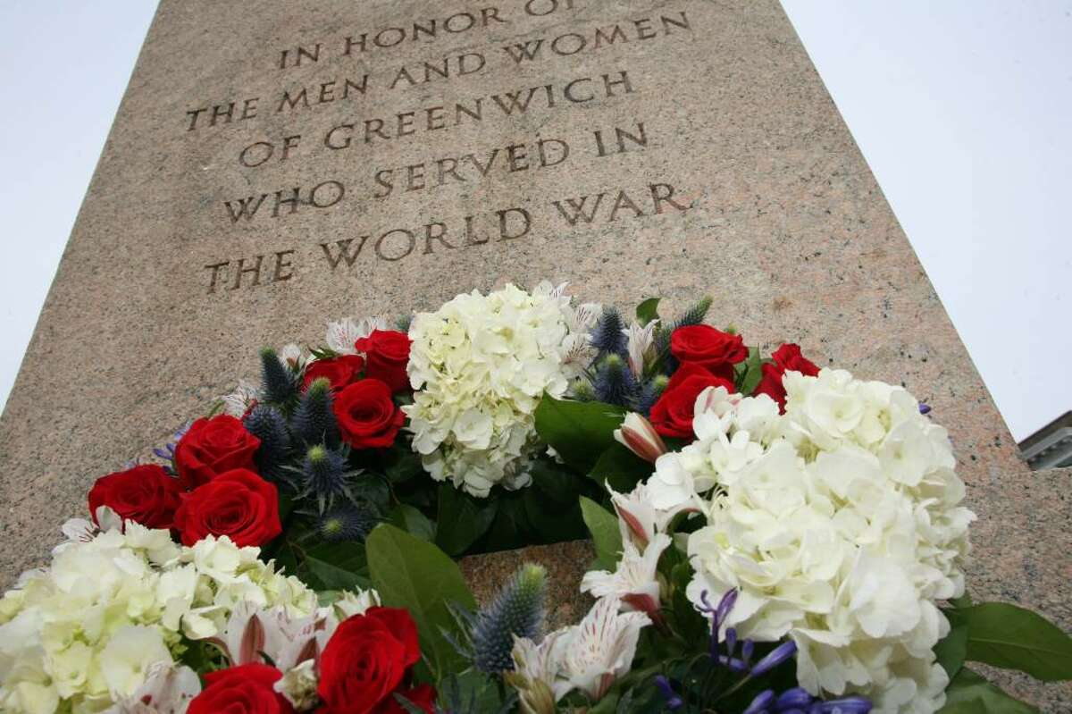 A wreath was layed at the bottom of the veterans memorial in front of the Greenwich Post Office on Greenwich Avenue.