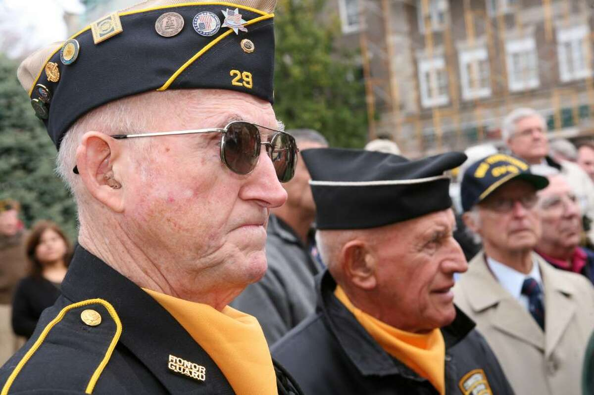 Korean War veterans Walter Casey and John Zmarzlak were just two of many veterans who turned out for Wednesdays ceremony in front of the Greenwich Post Office honoring those who served in the armed forces.