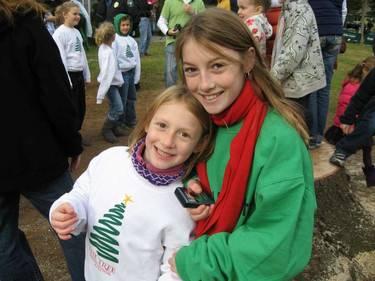 Claire and Kate McKinnon, sisters from Norwalk counted the rings in the stump of the Easton tree headed to Rockerfeller Center to serve as the Christmas tree. They claim the tree is 43 years old.