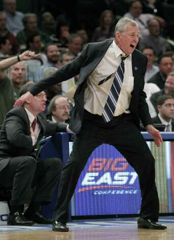 Connecticut head coach Jim Calhoun yells during the final moments of a quarterfinal game of the Big East NCAA college basketball conference tournament against Syracuse in New York, Thursday, March 8, 2012. Syracuse beat Connecticut 58-55. (AP Photo/Seth Wenig) Photo: Seth Wenig, ASSOCIATED PRESS / AP2012