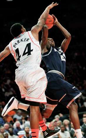 Cincinnati's Jaquon Parker (44) defends a shot by Georgetown's Jason Clark during a quarterfinal NCAA college basketball game in the Big East Conference tournament in New York, Thursday, March 8, 2012. Cincinnati won 72-70 in double overtime. Photo: Seth Wenig