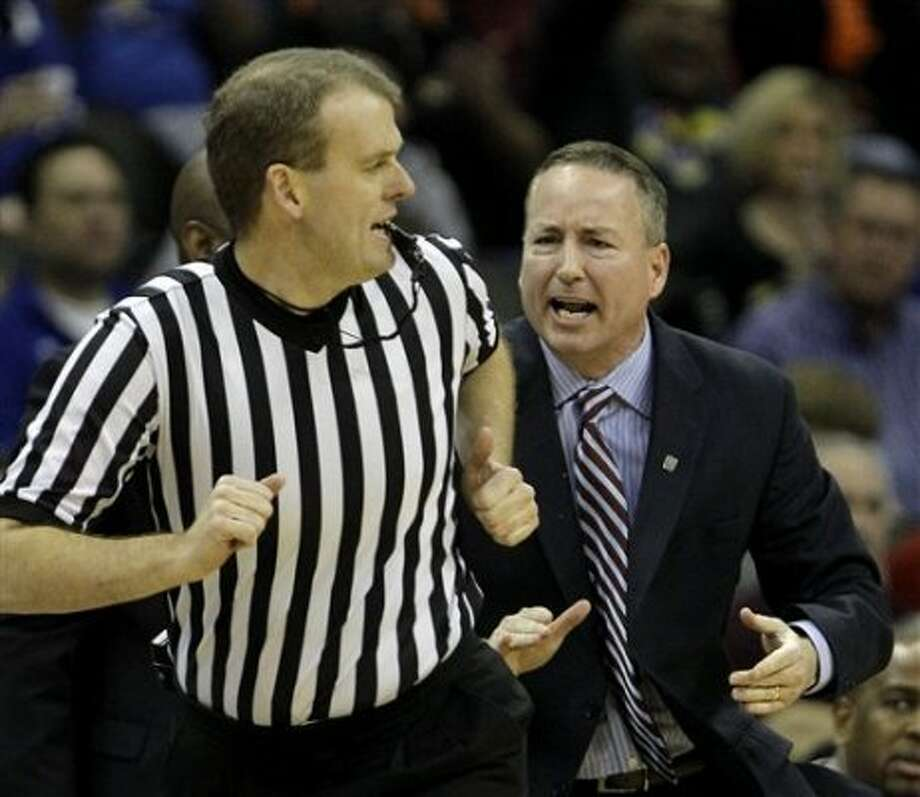 Texas A&M coach Billy Kennedy, right, disputes a call during the second half of an NCAA college basketball game against Kansas in the Big 12 Conference tournament on Thursday, March 8, 2012, in Kansas City, Mo. (AP Photo/Charlie Riedel) (AP)