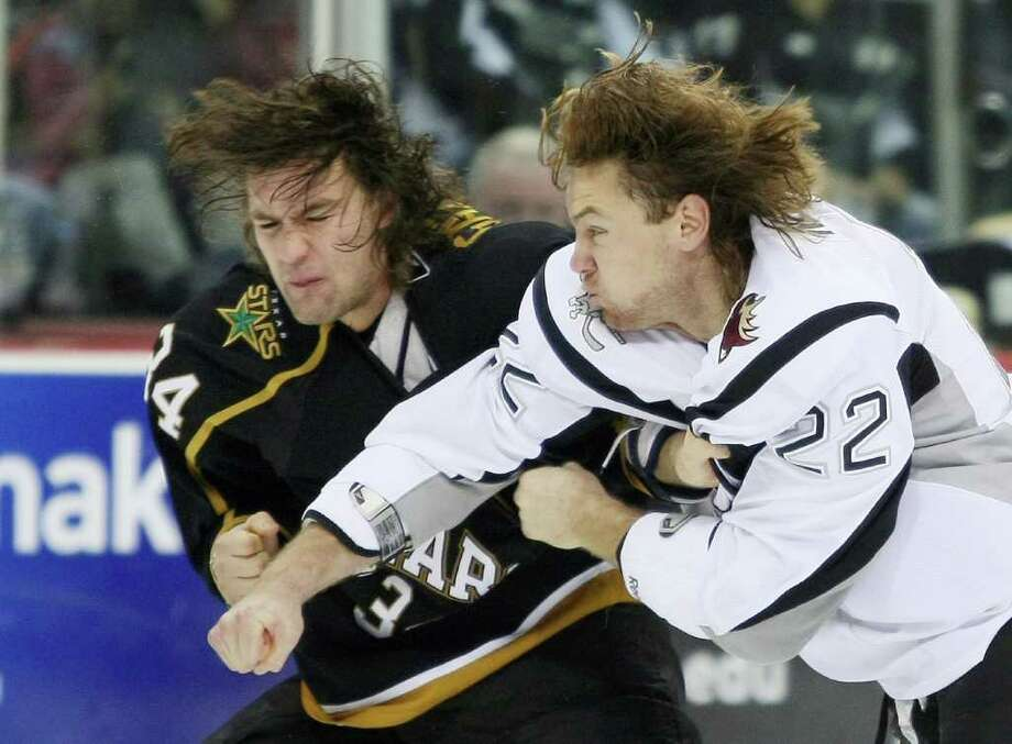 The players change, but the rivalry remains. Here, the Rampage's Eric Neilson (right) slugs the Stars' Luke Gazdic during a December 2010 game. Photo: Darren Abate, Darren Abate/pressphotointl.com / Darren Abate/pressphotointl.com