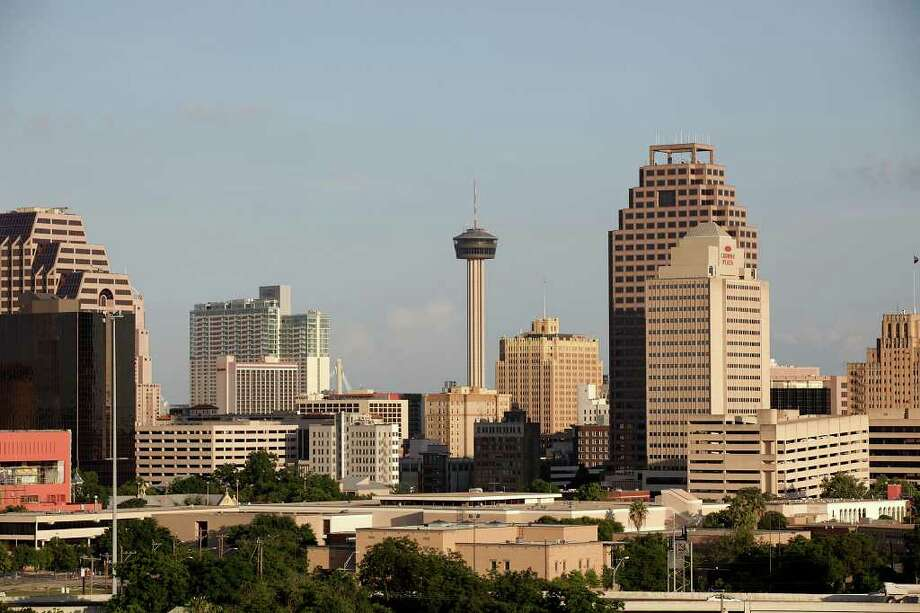 The San Antonio skyline shot from the Villa Tranchese. Photo: JERRY LARA, San Antonio Express-News / glara@express-news.net