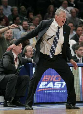 Connecticut head coach Jim Calhoun yells during the final moments of a quarterfinal game of the Big East NCAA college basketball conference tournament against Syracuse in New York, Thursday, March 8, 2012. Syracuse beat Connecticut 58-55. (AP Photo/Seth Wenig)