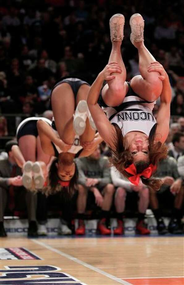 Connecticut cheerleaders  perform during the quarterfinals round of the Big East NCAA college  basketball conference tournament in New York, Thursday, March 8, 2012.  (AP Photo/Seth Wenig)