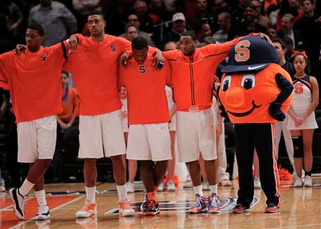 Syracuse players and the mascot line-up for the national anthem during the  quarterfinals round of the Big East NCAA college basketball conference  tournament in New York, Thursday, March 8, 2012. (AP Photo/Seth Wenig)