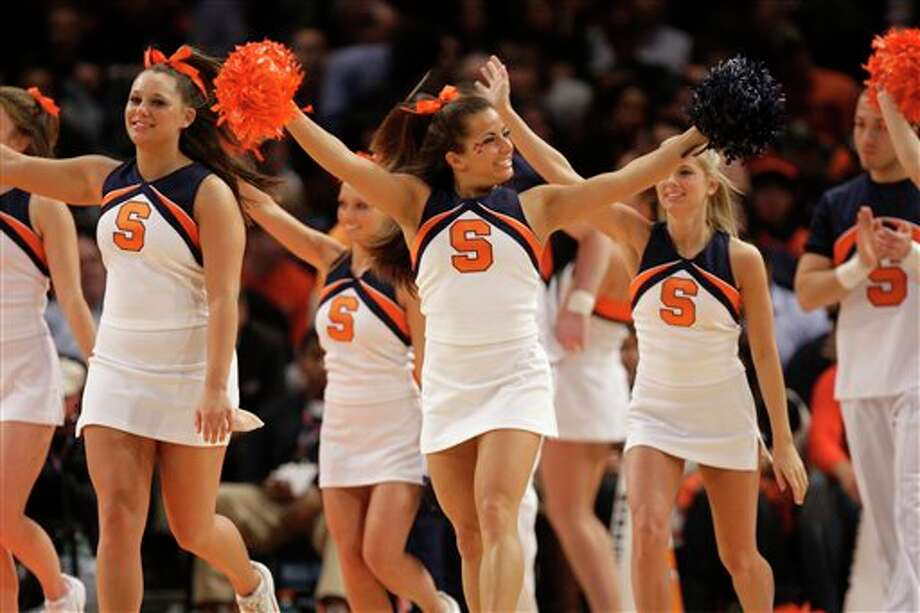 Syracuse cheerleaders perform during the quarterfinals round of the Big East NCAA college basketball conference tournament in New York, Thursday, March 8, 2012. Syracuse beat Connecticut 58-55. (AP Photo/Seth Wenig)