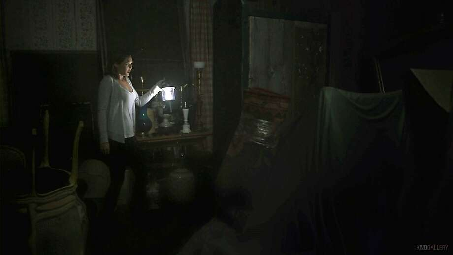 """Elizabeth Olsen stars in """"Silent House,"""" a thriller about a young woman trapped in a house and terrorized by ... someone. Photo: Open Road Films"""