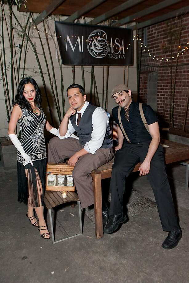 Cristina Rodriguez with Eli Rodriguez and Ricky Paiva at The Great Gatsby, the 1920's-themed benefit for Oasis for Girls presented by The Spinsters of San Francisco on Feb. 9 at the Rosewood Bar in San Francisco. Photo: Vasna Wilson, Drew Altizer