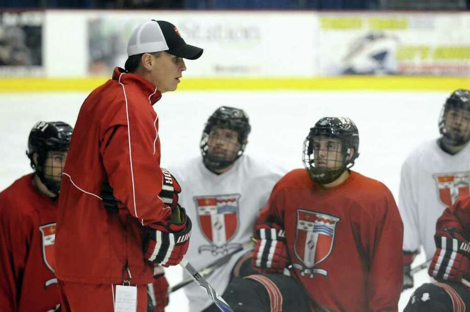 RPI hockey head coach Seth Appert,left,runs practice at the Houston Field House in Troy, NY Thursday March 8, 2012 ( Michael P. Farrell/Times Union ) Photo: Michael P. Farrell