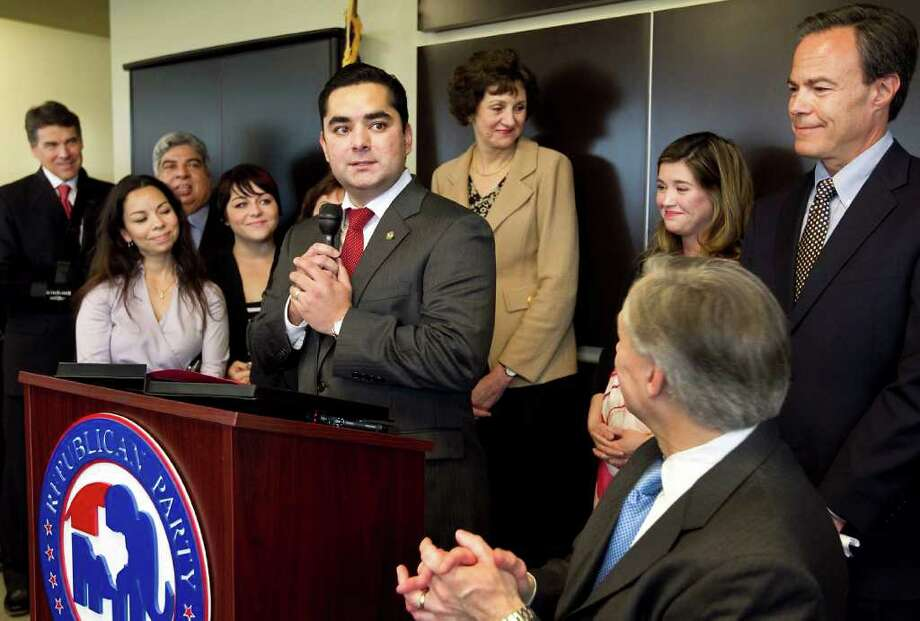 Flanked by family members and GOP notables, Democratic state Rep. J.M. Lozano announces that he's joining the Republican Party. Photo: Laura Skelding, Austin American-Statesman