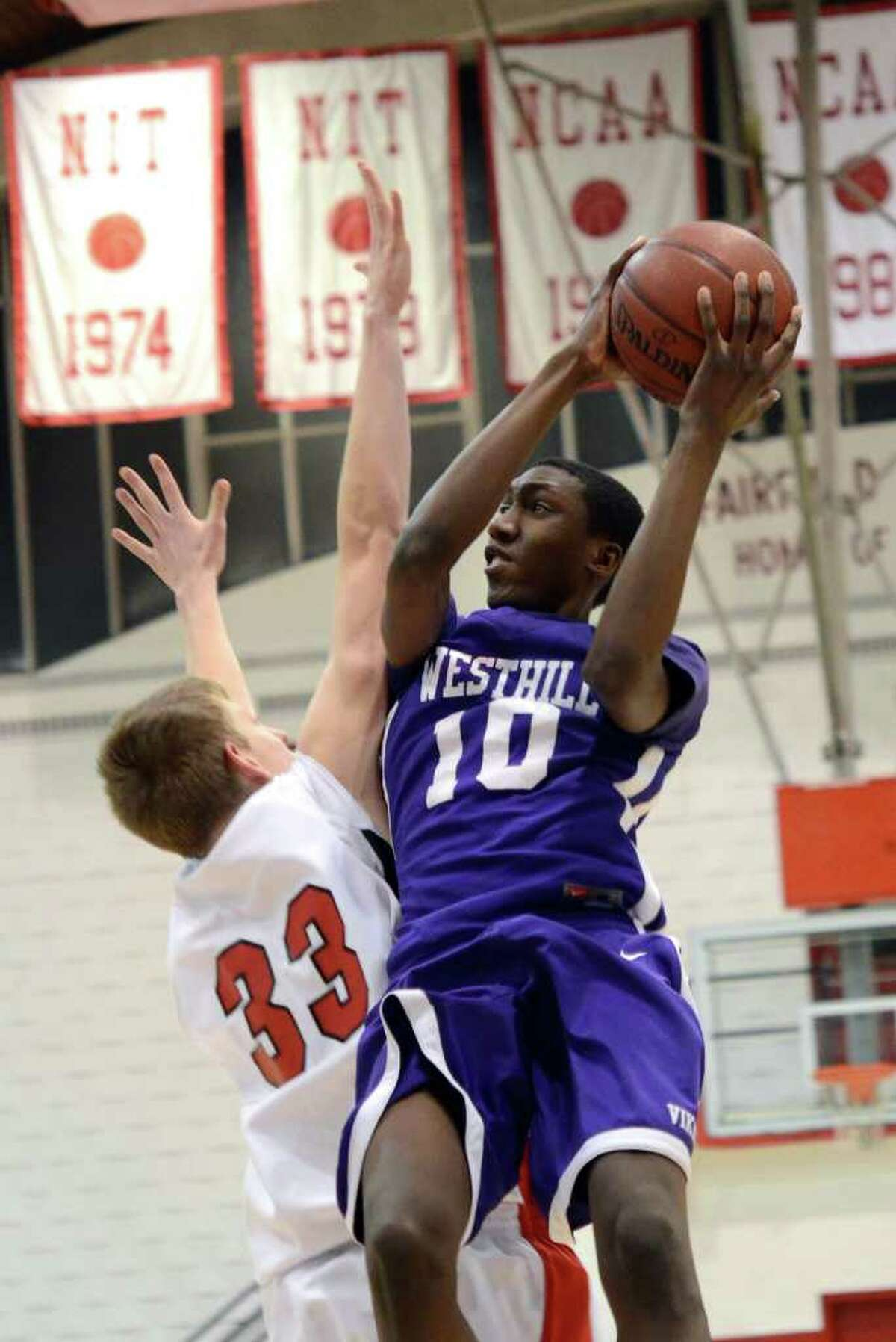 Westhill's Mark Edwin (10) goes up for a shot as Fairfield Prep's Tim Butala (33) defends during the second round of the Class LL boys basketball state tournament at Fairfield University's Alumni Hall on Thursday, Mar. 8, 2012.
