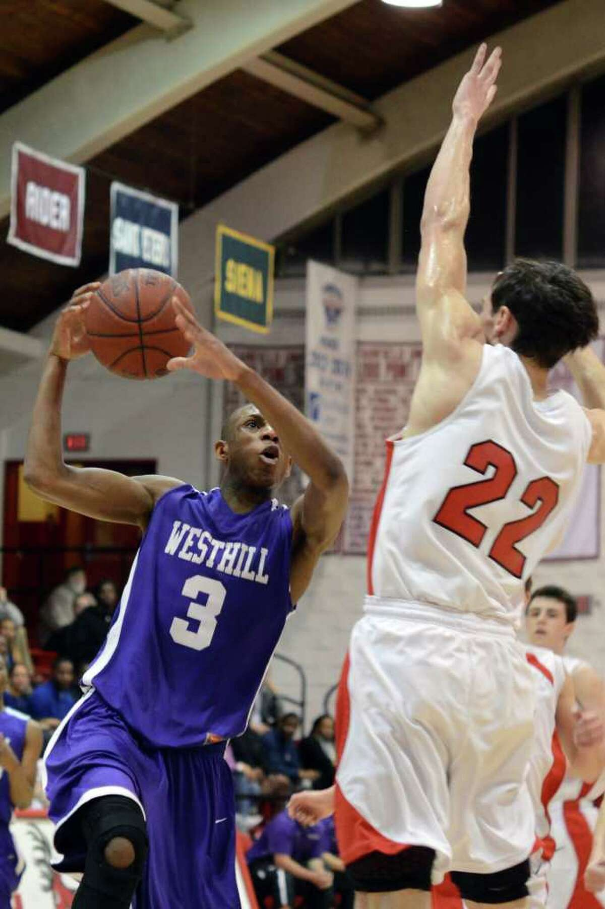 Westhill's Chris Walters (3) goes up for a shot as Fairfield Prep's Terry Tarpey (22) defends during the second round of the Class LL boys basketball state tournament at Fairfield University's Alumni Hall on Thursday, Mar. 8, 2012.